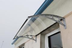 Stogelis virš durų BaBa 100x150cm aliuminis pilkas rėmas, skaidri danga Durų stogeliai
