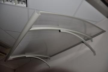 Durų stogelis STARKEDACH LENKTAS 160x100x25 cm. Pilkas rėmas. Durų stogeliai